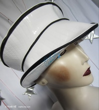 summer rain hat, black and white, crocodile imitation, elegant woman