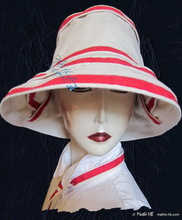 summerhat, sea wind, white sand and red linen