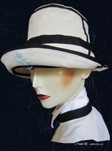 summer hat, white sand and night blue linen